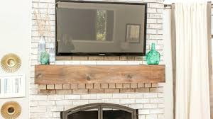 install tv above gas fireplace on wall flat screen decorations ideas home design excerpt stone romantic living room classic white mantel s