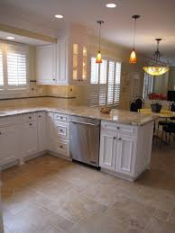 brown tile flooring with small and big square shape combined with l shape white wooden cabinet plus cream marble counter top of enchanting kitchen floor