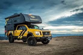 nissan titan camper rig truckcampermagazine com news hellwig products and lance campers team up icon bushwhacker torklift and more to build a nissan titan xd diesel rig for sema