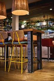 industrial style restaurant furniture. Industrial Rivet Machine Style Table With Timber Top Punchy Yellow Bar Poseur Height Stools Restaurant FurnitureRestaurant Furniture U