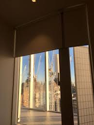 doors blackout roller blinds fitted outside the recess to large windows at modern blinds for large