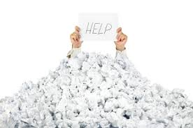 person under crumpled pile of papers a help sign isolated
