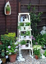 porch plant ideas i love this ladder plant holder in white in a small garden off