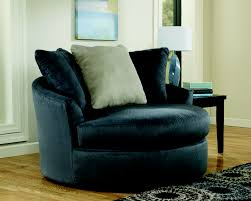 round gray fabric swivel chair with gray cream cushions also back