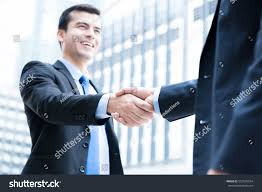 The Office The Merger Businessmen Making Handshake Front Office Buildings Stock Photo