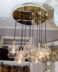 custom twelve globe chandelier with brass canopy