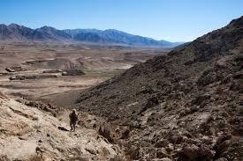u s department of defense photo essay u s marine corps gunnery sgt donnie bridges climbs a hill an afghan village in