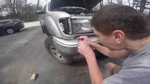 How to Install Headlight on a Toyota Tacoma - YouTube