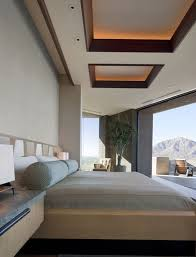 view in gallery softly lit sapele mahogany ceiling coffers complete this amazing bedroom design