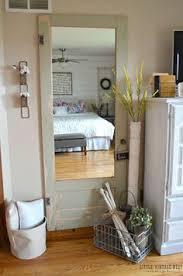 old door turned full length mirror little vine nest