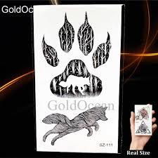 черная маленькая лапа временная татуировка женский боди арт енот кот долина