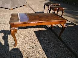 solid wood coffee table with glass top and calabria legs 0 8mwx0 3mdx0 3mh great condition