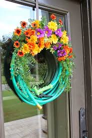 my wreath is a mix of fun and fancy so i did add a left over nozzle on it this wreath is also using up the end of a cut 50 hose