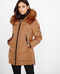 quilted down coat with faux fur trimmed hood by novelti