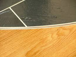 slate against hardwood floors ceramic tile metal edge strips flooring contractor talk re trim corner edging