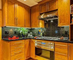 another shot of the same kitchen as above showcasing black galaxy as a full wall backsplash