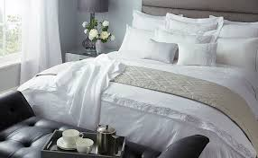 luxurious master bedroom made up with luxury bed linens