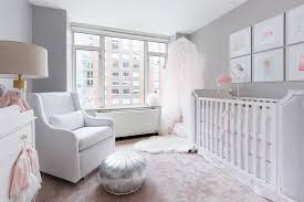 white and gray girls nursery with pink rug