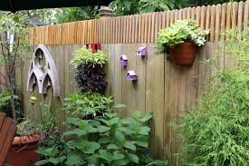 decoration: Beautiful Flowers Installedn On Simple Pot Which Is Placed On  Outdoor Fence Decorations Made