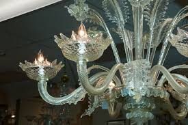 six light venetian chandelier has ridged glass arms and beatifully rendered daffodils and leaves
