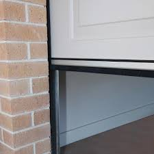 garage door which provides a watertight seal to 18mm above the floor level door dam is perfect for those garages at the bottom of a sloping driveway