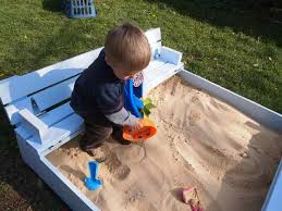 this nifty diy sandbox with built in seats is pure genius