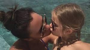 Milf kisses young girl