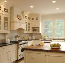Kitchens  Farmhouse Sink Ivory Kitchen Cabinets Soapstone Countertops Siland Butcher Block Subway