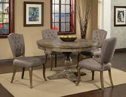 tufted leather gray round table with granite gray round table using warm wall color for cozy dining room decor