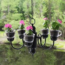 bring life back into your outdated chandelier and turn it into a beautiful and upcycled flower planter chandelier learn how