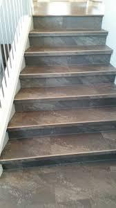 luxury vinyl tile installed with custom insert stair nosings