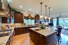backsplash for dark cabinets and light countertops kitchen traditional with double kitchen sink glass cabinets cabinet and lighting