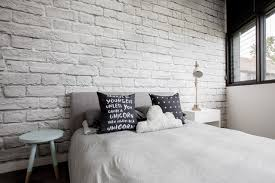 Brick Bedroom Furniture Inspiration For A Scandinavian Bedroom Remodel In Melbourne With White Walls Brick Furniture