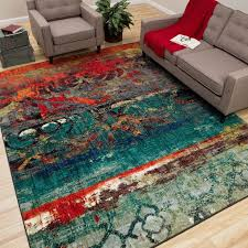 colorful rugs. This Colorful Area Rug Features Bright Hues Of Blue, Red And Orange To Create A Textured Look. The Contemporary Style Is Perfect For An Eclectic Styled Home Rugs