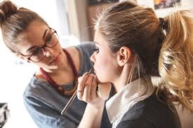 a freelance makeup artist does the makeup of a model