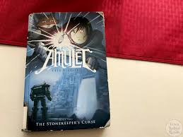 graphic novel review of the stonekeeper s curse by kazu kibuishi the stonekeeper s curse by kazu kibuishi is the second book in the amulet