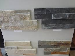 stunning fireplace refacing on interior with ledger stone tile backsplash es