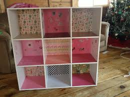 DIY Dollhouse. Menards 9 cubby bookshelf (assembly required) 20$, 18 12x12