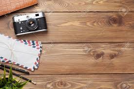 table top. Camera And Supplies On Office Wooden Desk Table. Top View With Copy Space Stock Photo Table E