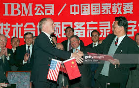 Bob Timpson , chairman of IBM China, shakes hands with Zuo Tieyong ...