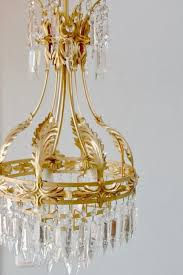 large chandelier brass mount with acanthus leaf motif and glass icicles ca 75