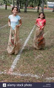 hispanic family activities. Miami Florida Kendall Family Festival Of The Arts Disabled Children Activities Hispanic Girls Potato Sack Race L