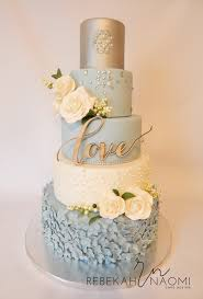 4 Tier Wedding Cake Designs 4 Tier Wedding Cake Ivory White And Dark Baby Blue With
