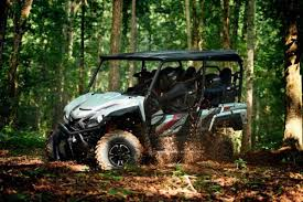 yamaha wolverine x4. standard wolverine x4 color options include graphite (msrp $15,999), yamaha blue with overfenders and cast aluminum wheels $16,499), realtree xtra n