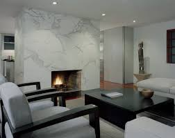view in gallery modern living room with a sleek marble fireplace