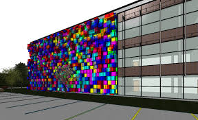 in this example we will be using ideate bimlink to manipulate over 700 curtain wall panels to create some colorful glass boxes with a variety of block