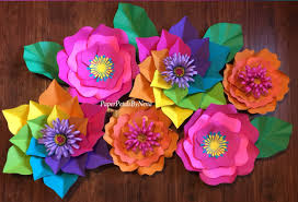 these gorgeous paper flowers from paper petals by nena come in all shapes and colors and would make perfect party decorations if you d rather diy your own
