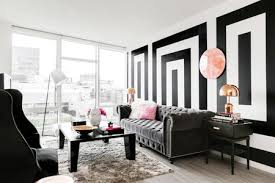 black and white living room with copper accents