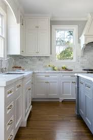 White Kitchen With Stacked Cabinets And Grey Island Interior