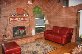 red leather couch family room tropical with specialty contractors
